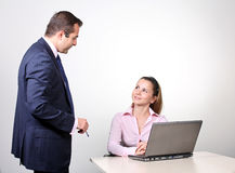 Businessman and female assistant Royalty Free Stock Photos