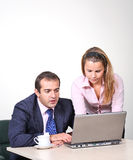 Businessman and female assistant Stock Images