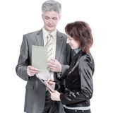 Businessman and female assistant discussing work issues. royalty free stock photography