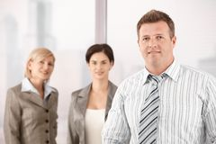 Businessman with female coworkers Stock Photo