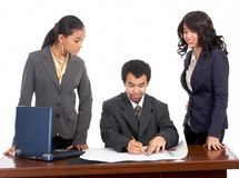 Businessman and female employees Royalty Free Stock Images