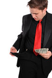Businessman with a few dollars Stock Photography