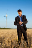 Businessman in a field Stock Photography