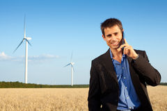Businessman in a field Royalty Free Stock Photos