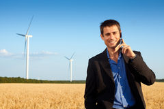 Businessman in a field Royalty Free Stock Images
