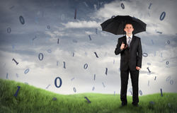Businessman on a field with binary code. Falling Royalty Free Stock Photo