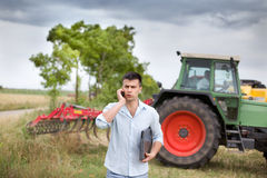 Businessman in the field Stock Images