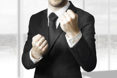Businessman fighter fists up Royalty Free Stock Photo