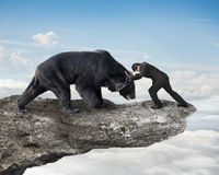 Free Businessman Fighting Against Black Bear On Cliff With Sky Clouds Royalty Free Stock Photography - 52488627