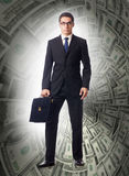 The businessman fighting against dollar funnel Royalty Free Stock Photo