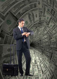 The businessman fighting against dollar funnel. Businessman fighting against dollar funnel Stock Images