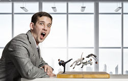 Businessman fighting on the chessboard Stock Photography