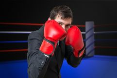 Businessman is fighting and hiding his face in ring Stock Photography