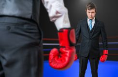 Businessman is fighting with his boss in boxing ring Stock Photo