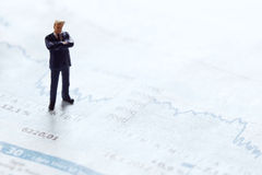 Businessman figure on a stock chart Stock Images