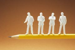 Businessman Figures on Pencil stock photos