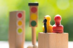 Businessman figures standing on wooden block with pawn. Miniature people: Businessman figures standing on wooden block with pawn ready for business negotiations stock photos