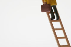 Businessman Figurine Climbing Ladder Stock Images