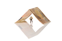Businessman figurine running on a euro banknote. Isolated on white with clipping path Royalty Free Stock Photo