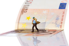 Businessman figurine running on a euro banknote. Isolated on white with clipping path royalty free stock photography