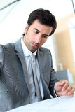Businessman filling business contract Royalty Free Stock Image