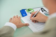 Businessman filling car sale contract form Stock Image