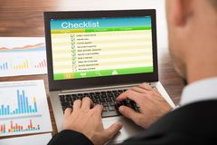 Businessman filling checklist form Stock Photo