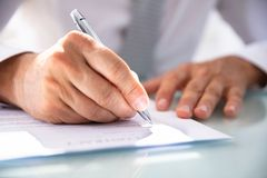 Businessman Filling Contract Form stock photography