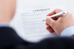 Businessman filling the contract form Royalty Free Stock Photo