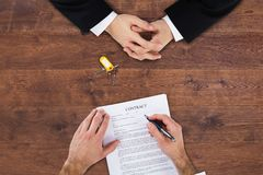 Businessman Filling Contract Form royalty free stock photography