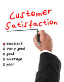 Businessman filling a customer satisfaction form. With a marker Stock Photo