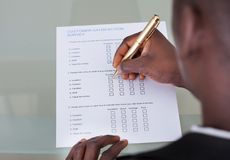 Businessman filling form Royalty Free Stock Images