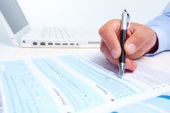 Businessman filling the form. Royalty Free Stock Image