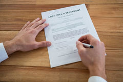 Businessman filling last will and testament form Stock Photos