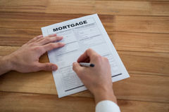 Businessman filling mortgage contract form. In office Royalty Free Stock Image
