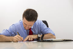 Businessman filling paper documents Royalty Free Stock Image