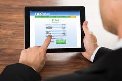 Businessman filling tax return form Stock Images