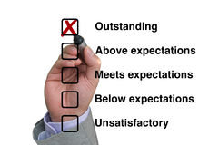 Businessman fills out performance rating Royalty Free Stock Photos