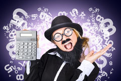 Businessman with finance growth and credit surplus. Image of a super excited male financial controller holding calculator showing credit surplus with finance Royalty Free Stock Photography
