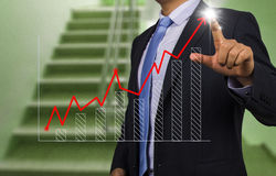 Businessman with financial chart Stock Images