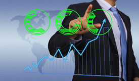 Businessman with financial chart Stock Photo