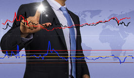 Businessman with financial chart Royalty Free Stock Photos