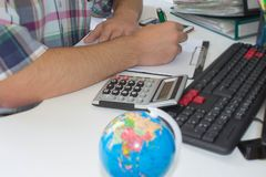 Businessman financial inspector and secretary making report, calculating or checking balance. Internal Revenue Service inspects ch Stock Photography