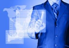 Businessman with financial symbols stock photo
