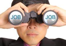 Businessman find JOB through binoculars Stock Photos
