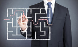 Businessman finding the solution of a maze. Drawn with chalk Royalty Free Stock Photo