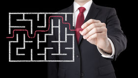Businessman finding the solution of a maze Royalty Free Stock Photos