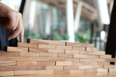 Finger climbing stairs made by wood block. hand walking up step. Businessman finger climbing stairs made by wood block. hand walking up step by step. growth Stock Images