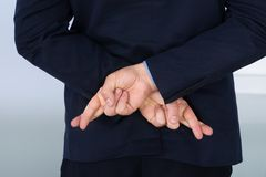 Businessman with finger crossed Royalty Free Stock Photography