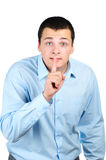 Businessman with finger on his lips Royalty Free Stock Photography